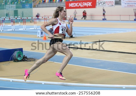ISTANBUL, TURKEY - FEBRUARY 21, 2015: Turkish athlete Meryem Kasap running 4x400 relay race during Balkan Athletics Indoor Championships in Asli Cakir Alptekin Athletics hall. - stock photo