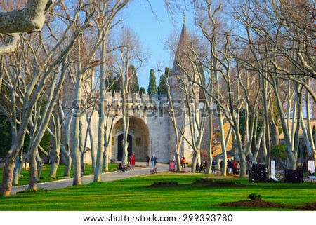 ISTANBUL,TURKEY - JAN 14: Tourists entering the Gate of Salutation of Topkapi Palace on January 14, 2015 in Istanbul, Turkey. It  was the primary residence of the Ottoman Sultans. - stock photo