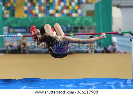 ISTANBUL, TURKEY - JANUARY 10, 2016: Athlete Gonul Koksal high jumpes during Turkish Athletic Federation Olympic Threshold Indoor Competitions
