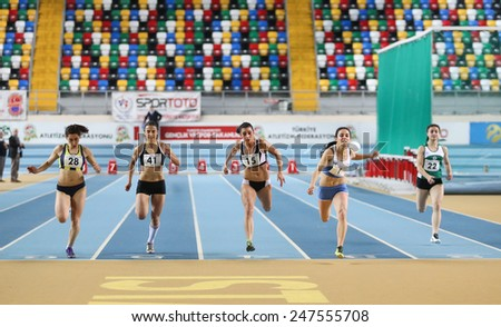 ISTANBUL, TURKEY - JANUARY 24, 2015: Athletes run during Turkish Athletic Federation Indoor Athletics Competition in Asli Cakir Alptekin Athletics hall - stock photo