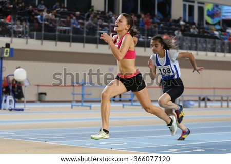 ISTANBUL, TURKEY - JANUARY 10, 2016: Athletes running 60m hurdles during Turkish Athletic Federation Olympic Threshold Indoor Competitions - stock photo