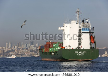 ISTANBUL,TURKEY - January 22,2015 : conventional ferry boats of istanbul and container ship  on bosphorus,istanbul Turkey - stock photo