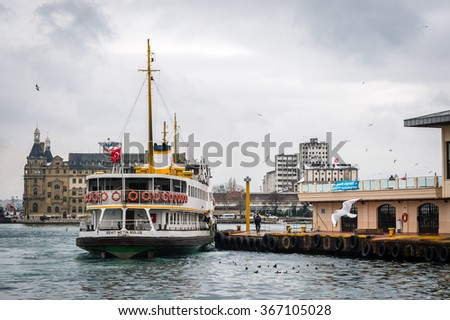Istanbul, Turkey - January 18, 2016: Ferry workers strengthens ship   on the shore. Ferryboat in pier of Kadikoy in Istanbul, Turkey