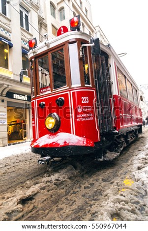 Istanbul, Turkey - January 7, 2017: Istanbul under heavy snow on January 7. The locals and visitors enjoy walking on snow on Istiklal Avenue and Taksim Square, Istanbul Turkey.
