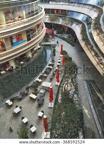 ISTANBUL, TURKEY - JANUARY 9, 2015: Kanyon Shopping Mall that is open air in a modern district of Levent in Istanbul. Levent is a financial center of the city with shopping malls and business offices. - stock photo