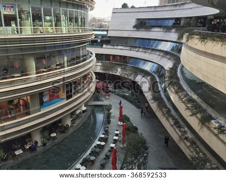 ISTANBUL, TURKEY - JANUARY 9, 2015: Kanyon Shopping Mall that is open air in a modern district of Levent in Istanbul. Levent is a financial center of the city with shopping malls and business offices.