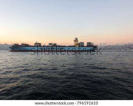 ISTANBUL, TURKEY - JANUARY 6 2018: Maersk Kyrenia cargo container ship passes through the strait of the Bosporus at sunset