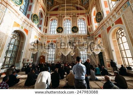 ISTANBUL, TURKEY - JANUARY 23: Ortakoy Mosque interior.Muslim men praying in a ortakoy mosque inside  on JANUARY 23, 2015 in Istanbul, Turkey .  - stock photo