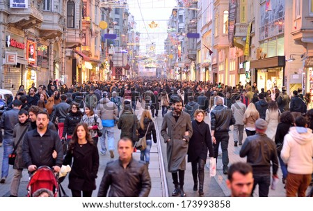 ISTANBUL, TURKEY - JANUARY 12: People walking on Istiklal Street January 12, 2014 in Istanbul Turkey. It is the most famous street in Istanbul visited by nearly 3 million people a single weekends day - stock photo