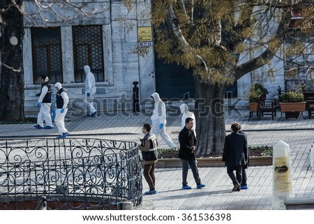 ISTANBUL, TURKEY - JANUARY 12: Police forensic officers attend the scene after an explosion in front of the German Fountain in Sultanahmet Square in Istanbul on January 12, 2016 in Istanbul, Turkey. - stock photo
