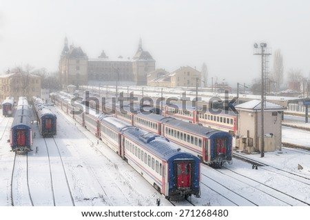 ISTANBUL, TURKEY, JANUARY 1, 2012: Snow and fog on the train parking area of Haydarpasa Train Station, along with Sirkeci Terminal, they are Istanbul's two intercity and commuter railway terminals. - stock photo