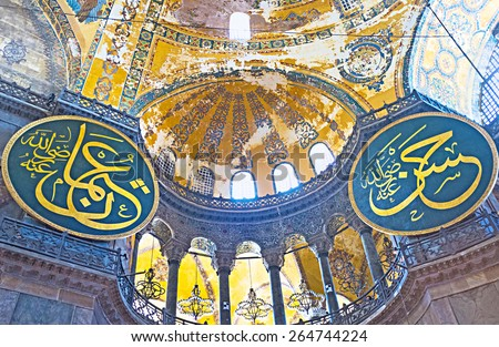 ISTANBUL, TURKEY - JANUARY 13, 2015: The ancient walls and ceiling of Hagia Sophia  with the calligraphic medallions, on January 13 in Istanbul. - stock photo
