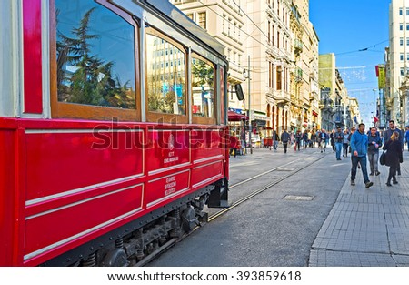 ISTANBUL, TURKEY - JANUARY 22, 2015: The main transport in Independence Avenue is the retro tram of Nostalgia Tramway, connecting the Taksim Square and Tunel, on January 22 in Istanbul.