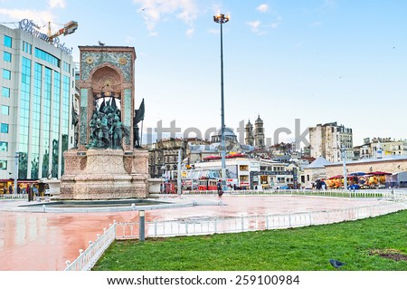 ISTANBUL, TURKEY - JANUARY 13, 2015:The Republic Monument is a notable landmark, located at Taksim Square, to commemorate the formation of the Turkish Republic, on January 13 in Istanbul. - stock photo