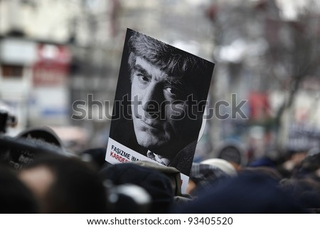 "ISTANBUL,TURKEY-JANUARY 19: Thousands marched for the fifth anniversary of journalist Hrant Dink's murder in Istanbul, Turkey on Jan 19,2012. People held placards that read ""We are all Armenians,we are all Hrant"""