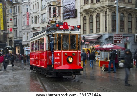 ISTANBUL,TURKEY- January 02: Unidentified pedestrians walk down Istiklal Street on a snowy day on January 02, 2016 in Istanbul, Turkey.Istiklal Street is one of the popular destinations in Istanbul. - stock photo