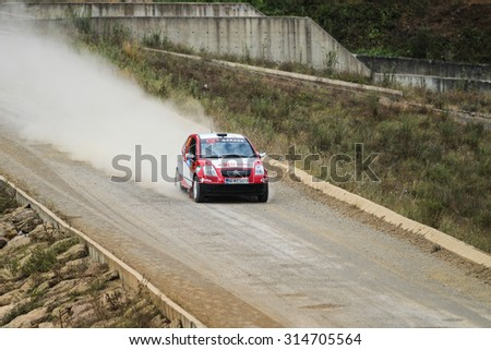 ISTANBUL, TURKEY - JULY 25, 2015: Alptekin Isikalp drives Citroen C2 GT in Bosphorus Rally 2015, Deniz stage