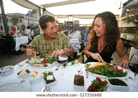 ISTANBUL, TURKEY - JULY 8: Couple eating Turkish food in the restaurant on July 8, 2010 in Istanbul, Turkey.