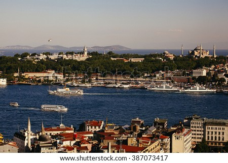 ISTANBUL,TURKEY- JULY 15, 2013: Cruise ferries in Eminonu Port, major dock for ferryboat,  near Yeni Cami and Galata Bridge.