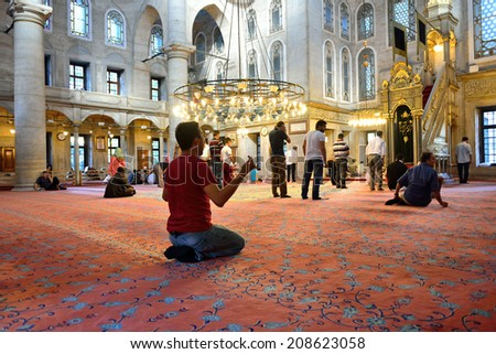 ISTANBUL, TURKEY - JULY 24: Eyup Sultan mosque muslims who pray, 24 July 2014 in Istanbul Turkey. Eyup mosque was built in 1458 and the mosque of Istanbul is the most visited. - stock photo