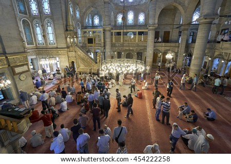 ISTANBUL, TURKEY - JULY 1: Eyup Sultan mosque muslims who pray, 1 July 2016 in Istanbul Turkey. Eyup mosque was built in 1458 and the mosque of Istanbul is the most visited. - stock photo