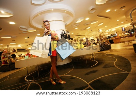 ISTANBUL, TURKEY - JULY 22: Famous Turkish fashion model, show host and actress Ozge Ulusoy portrait on July 22, 2010 in Istanbul, Turkey.