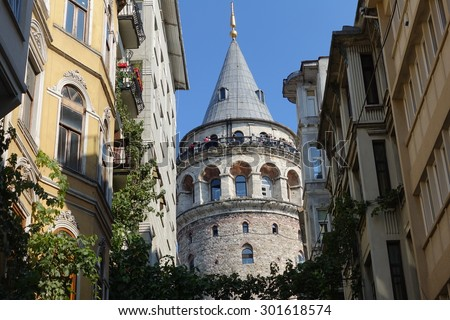 ISTANBUL, TURKEY JULY 30, 2015:Galata tower in istanbul. A view of the front of the Galata Tower in Istanbul's streets.  - stock photo