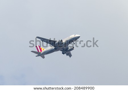 ISTANBUL, TURKEY - JULY 13, 2014: Germanwings Airbus A319-132 landing to Sabiha Gokcen Airport. Germanwings is a low-cost airline with 74 fleet size, owned by Lufthansa - stock photo