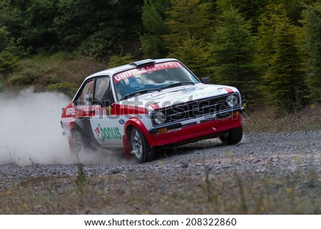 ISTANBUL, TURKEY - JULY 13, 2014: Kerem Ustunkaya drives Ford Escort MK2 of Bonus Unifree Parkur Racing Team in 35. Istanbul Rally, Gocbeyli Namet Stage