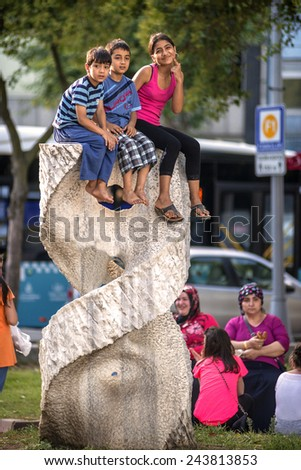 ISTANBUL, TURKEY - JULY 07: Kids over a park sculpture on July 07, 2014, in Istanbul, Turkey