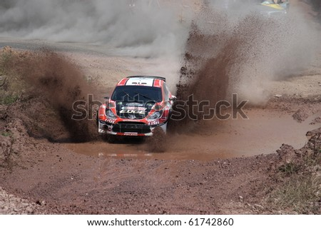 ISTANBUL, TURKEY - JULY 25: Maclej Oleksowicz drives a Castrol Trw Motointegrator Ford Fiesta S2000 car during Bosphorus Rally 2010 ERC championship, Ballica Stage on July 25, 2010 in Istanbul, Turkey - stock photo
