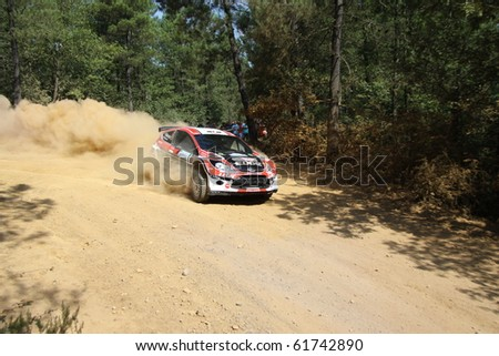 ISTANBUL, TURKEY - JULY 25: Maclej Oleksowicz drives a Castrol Trw Motointegrator Ford Fiesta S2000 car during Bosphorus Rally 2010 ERC championship, Mudarli Stage on July 25, 2010 in Istanbul, Turkey - stock photo