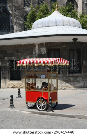 Istanbul, Turkey â?? July 7, 2015: Nice red street market cart with freshness bread near New Mosque - stock photo