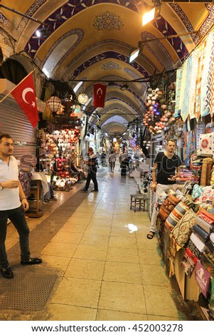 ISTANBUL, TURKEY - JULY 09, 2016: People shopping in the Grand Bazaar. The Grand Bazaar is one of the largest and oldest covered markets in the world.