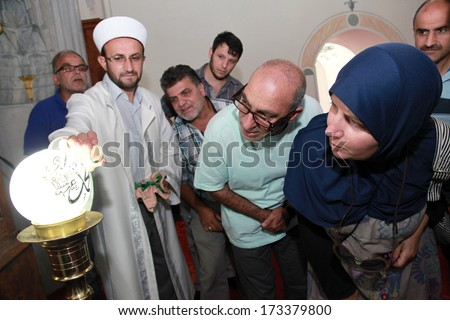 ISTANBUL, TURKEY - JULY 23: Prayer leader (imam) showing Prophet Mohammad�s Beard at Arap Mosque on July 23, 2013 in Istanbul, Turkey. Mosque was originally a Roman Catholic Church erected in 1325. - stock photo