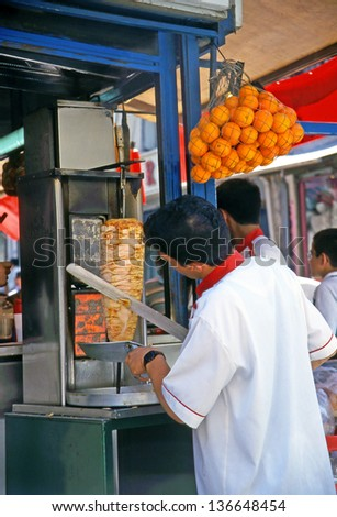 ISTANBUL, TURKEY- JULY 18: Street Vendors offers traditional kebabs on July 18, 2000 in Istanbul, Turkey. Istanbul not lose anything of its oriental atmosphere.