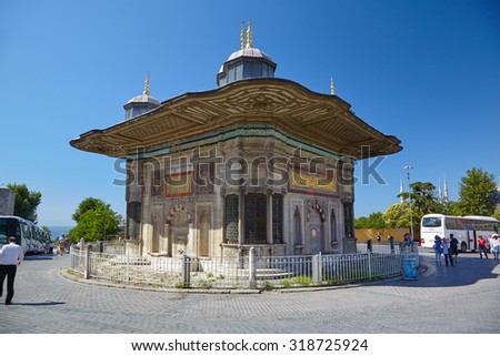 ISTANBUL, TURKEY - JULY 12, 2014: The Fountain of Sultan Ahmed III.  The rococo style fountain located in the great square in front of the Imperial Gate of Topkapi Palace in Istanbul, Turkey.