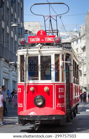 ISTANBUL, TURKEY - JULY 21, 2015 : The Taksim Tunel Nostalgia Tram trundles along the istiklal street and people at istiklal avenue