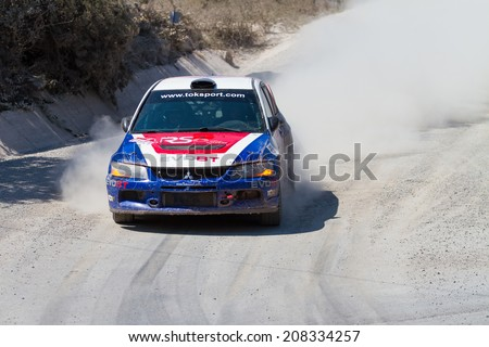 ISTANBUL, TURKEY - JULY 13, 2014: Ugur Soylu drives Mitsubishi Lancer Evo 9 of Toksport WRT Team in 35. Istanbul Rally, Ulupelit ITO Stage