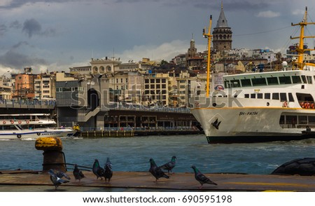 Istanbul, Turkey, July 16, 2017, View of the Bosphorus and city from the pier Eminonyu, View of the Galata Tower from the pier Eminenyu Sea passenger ship.