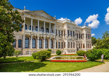 ISTANBUL, TURKEY - JUN 22, 2014: A scenic view of one of the buildings of the palace of the Ottoman sultans Dolmabahce and the park with a fountain
