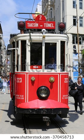 ISTANBUL,TURKEY-JUNE 7:A historic red tram in front of the Galatasaray High School at the southern end of istiklal Avenue.June 7,2015 in Istanbul,Turkey.