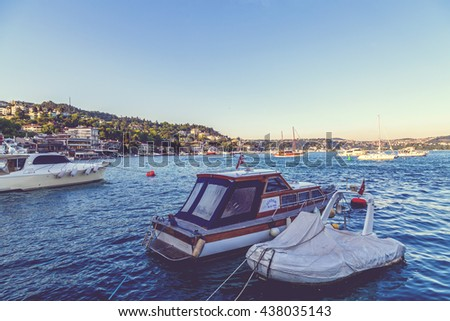 Istanbul, Turkey - June 4, 2016: Coastal view of Bebek district by the Bosphorus. Boats and yachts on the blue waters of the Bosphorus between the Asian and European continents.