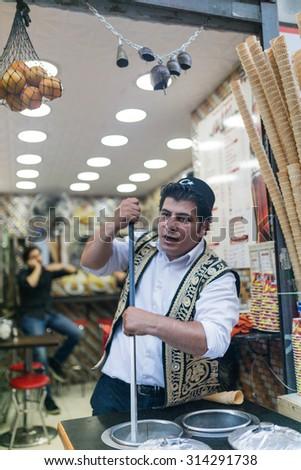 ISTANBUL, TURKEY - JUNE 20: Dondurma restaurant worker on June 20, 2015 in Istanbul, Turkey - stock photo