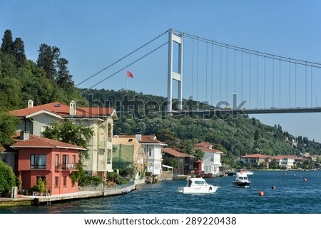 ISTANBUL, TURKEY, JUNE 8, 2013 :Fatih Sultan Mehmet Bridge and the coastline of Kanlica with manors and mansions, one of the famous shores at Bosphorus, Istanbul, Turkey. - stock photo