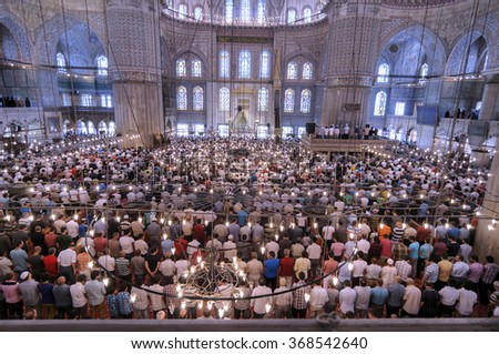 ISTANBUL, TURKEY - JUNE 29: Muslims preparing during the prayer Sultanahmet Mosque on June 29, 2012 in Istanbul, Turkey. Blue Mosque, built in the 17th century by the architect Mehmet Aga. - stock photo