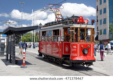 ISTANBUL, TURKEY - JUNE 10: Old-fashioned red tram at the streets of Istanbul on JUNE 10, 2016. Nostalgic tram is the heritage tramway system.It was re-established in 1990 and gained much popularity.