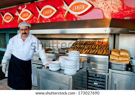 ISTANBUL, TURKEY - JUNE 25, 2010: Outdoor cafe chef, June 25, 2010 in Istanbul, Turkey. Istanbul - Turkey's largest city, main commercial, industrial and cultural center, main port of country. - stock photo