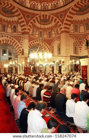 ISTANBUL, TURKEY - JUNE 23: People praying at Ramadan night in Validei Atik Mosque on June 23, 2013 in Istanbul, Turkey. - stock photo