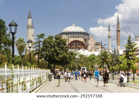 ISTANBUL, TURKEY, JUNE 30, 2015: People walking at Sultanahmet Square, Hagia Sophia can be seen at the background. Sultanahmet District is the heart of old Istanbul. - stock photo
